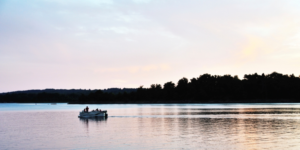 Boat on the water at dusk/dawn.