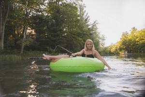 Girl tubing on the river