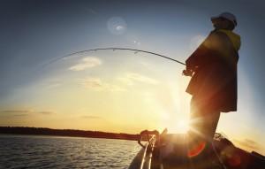 man boating at sunset